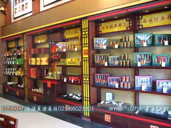 【设计说明】:此款烟酒展示柜从打样到切料到车料再到油漆,包装一